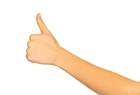 Female hand giving thumbs up gesture on white