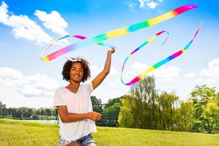 Girl wave color ribbon smiling and enjoying summer Banco de Imagens
