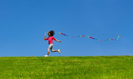 Little small black cool girl wave with ribbon 免版税图像