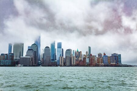 New York downtown with low clouds over Hudson bay