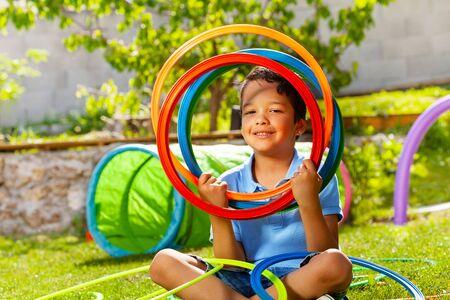 Cute nice boy portrait hold color hoop rings