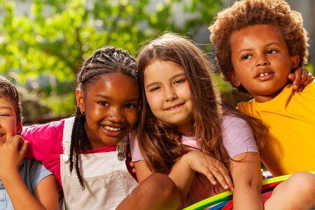 Close-up portrait of kids group hug and smiling Banco de Imagens