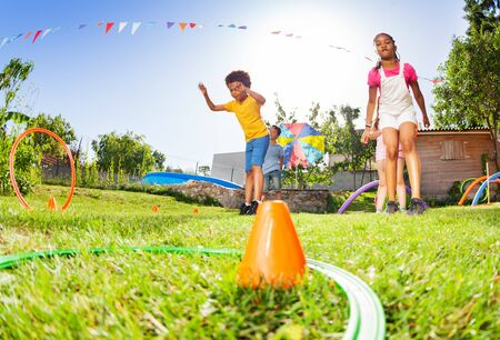 Boy and girl throw hoops rings to target