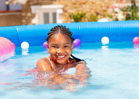 Beautiful black girl swim in swimming pool water