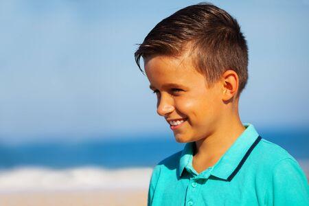 Profile portrait of a smiling boy on the sea beah Stok Fotoğraf