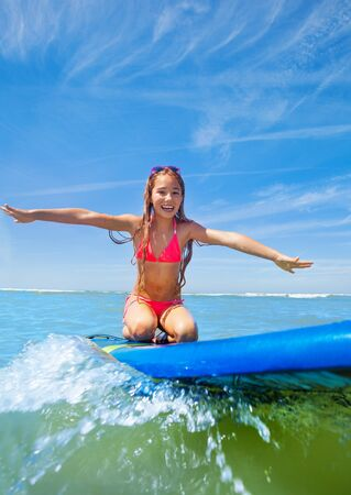Little surfer girl board have fun on surfboard