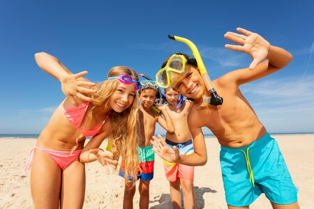 Kids on vacation with snorkeling mask wave hands