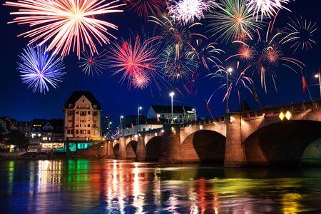 Mittlere Brucke middle bridge across Rhine river at night, Basel during fireworks celebration