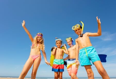 Group of four kids together portrait on the beach Banque d'images