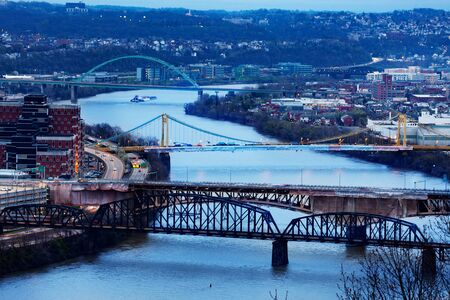 Night view of Panhandle Liberty and South Tenth Street Bridges in Pittsburg over Monongahela river