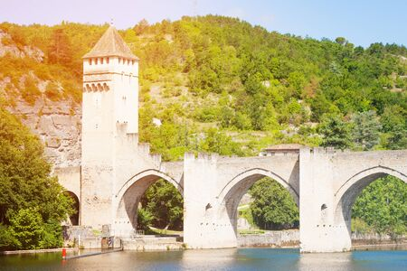 Mountain, Lot river and Valentre bridge in Cahor Stock Photo
