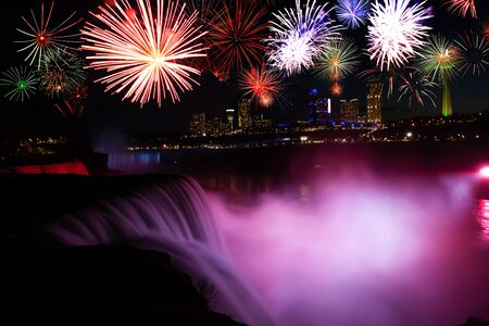Niagara falls at dusk view with celebration fireworks in the night sky