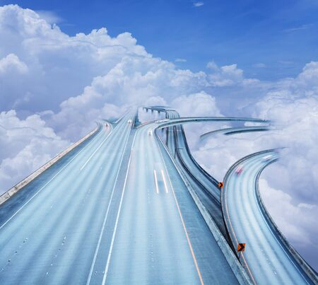 Concept of the highway intersection in clouds sky