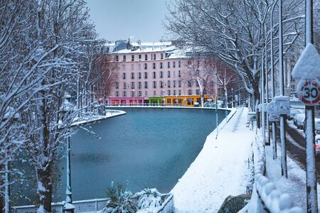 Canal Saint Martin in Paris covered with snow