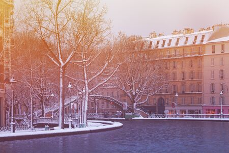 Bridge on Canal Saint Martin in Paris under snow