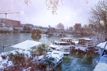 Flooded Seine and barges covered with snow, Paris