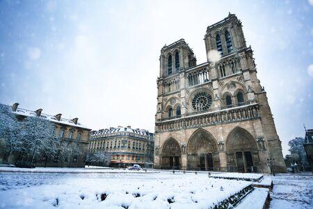 Square in front of Notre Dame de Paris under snow