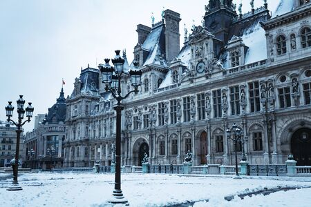 Hotel de Ville townhall square under snow in Paris