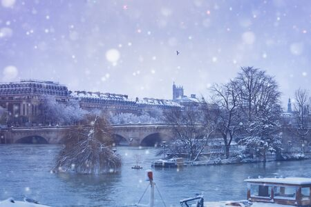 Flooded Seine banks and bridges in snow Paris, day
