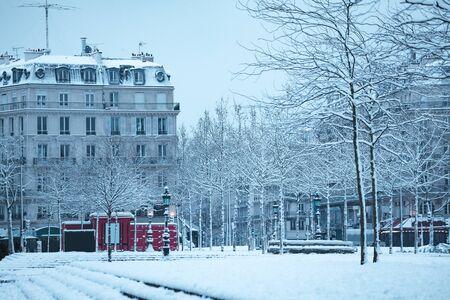 Republic square and street in Paris under snow