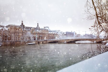 Flooded Seine river in Paris downtown under snow 写真素材