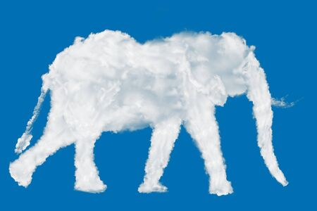 Elephant icon shape made of clouds on blue background over sky Stockfoto