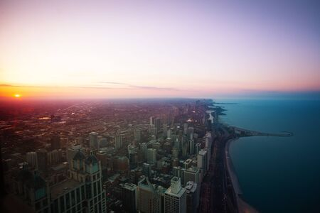 Chicago downtown panorama at sunset dusk with Concrete beach on Michigan and interstate 41 highway