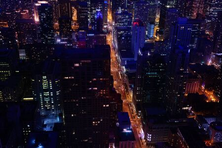Illuminated at night busy streets of Chicago downtown view from above, Illinois, USA 版權商用圖片