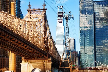 Roosevelt Island tramway system and Ed Koch Queensboro Bridge over New York buildings across East river, NY, USA