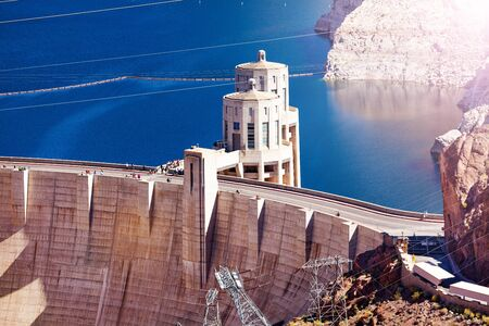 Tower on the concrete arch-gravity Hoover Dam in the Black Canyon of the Colorado river on Nevada Arizona border