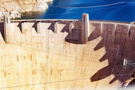 Great wall of Hoover Dam made of concrete in the Black Canyon of the Colorado river on Nevada Arizona border