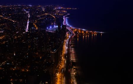 Chicago downtown view of interstate 41 highway at night with Concrete beach on Michigan lake