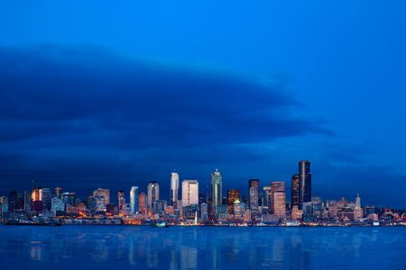 Seattle waterfront downtown buildings wide skyline view at night, Washington, USA