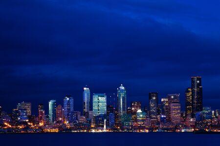 Panorama of Seattle city night downtown view skyline over Elliot bay, WA, USA