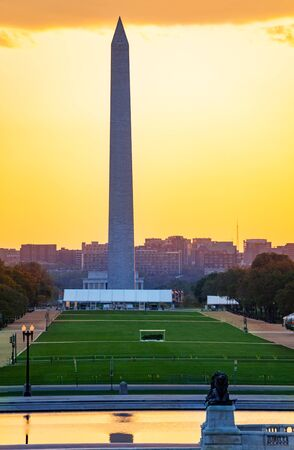 George Washington Monument obelisk to commemorate in D.C. USA over yellow sunset Фото со стока