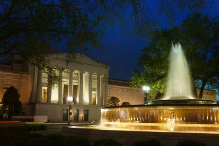 National Archives Research Center in Washington DC, at night with fountain on foreground, USA Stock Photo