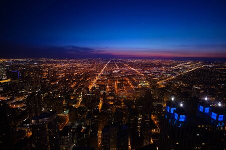 Long view of Chicago city suburban panorama from above at night