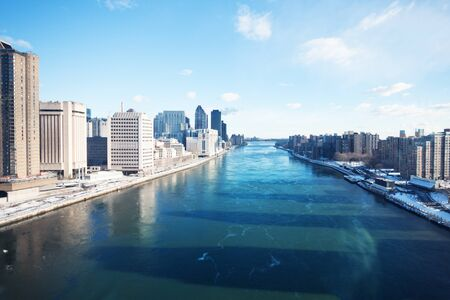 Frozen winter East river view from Roosevelt Island tramway in New York, NY, USA Stock Photo