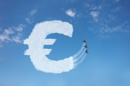 Euro currency buy price growth and volatility concept with sign element made of clouds on blue background over sky, jet plane pull cloud up