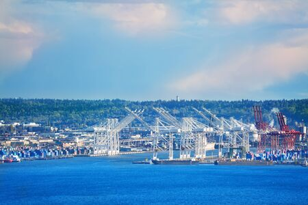 Port of Seattle with cranes and docks for ships over Elliot bay, Washington, USA