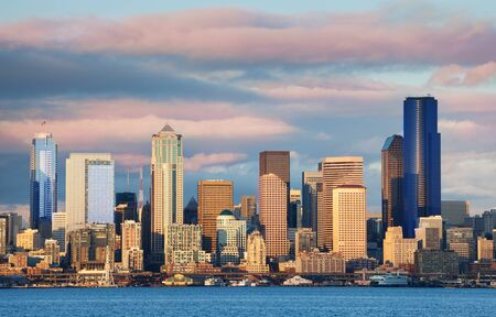 Seattle waterfront downtown buildings skyline view at evening sunset on spring day, Washington, USA