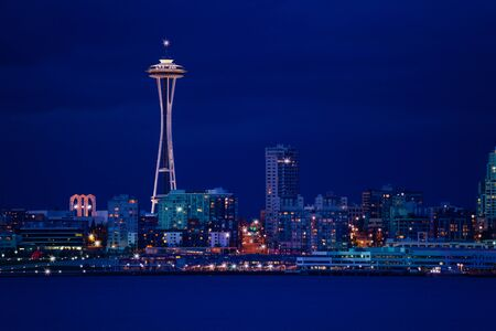 View of Seattle town at night over Elliot bay in front, WA, USA
