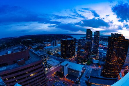 Evening panorama of Bellevue city downtown of King County, United States across Lake Washington from Seattle