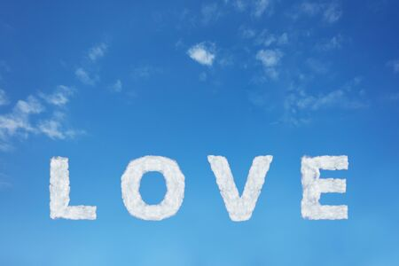 Love sign made of clouds letters over clear day blue sky Imagens
