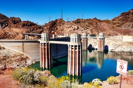 Water releasing towers of Hoover Dam made of concrete in the Black Canyon of the Colorado river on Nevada Arizona border