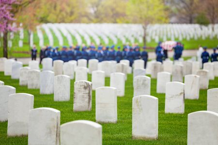 Military cemetery and burial procession with soldiers on background Stock Photo