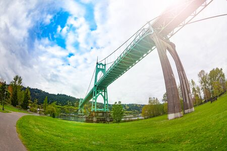 St. Johns Bridge in Portland from park below the steel suspension construction with dual gothic-style towers, built in 1931, USA Stock Photo
