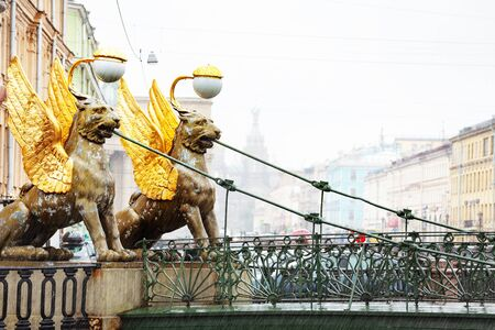 Two Griffins on Bank bridge crossing the Griboedov Canal near the former Banking Assignation in Saint Petersburg, Russia Archivio Fotografico