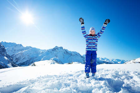 Happy young beautiful ski girl portrait stand in snow over mountain top range view