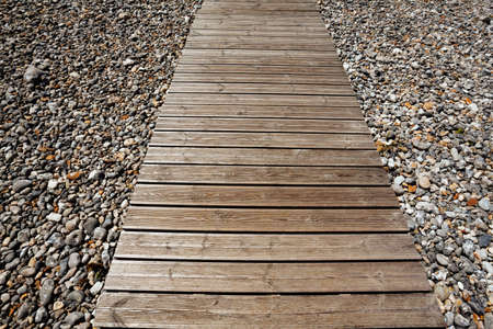 Pebble beach wooden deck close-up clean view image